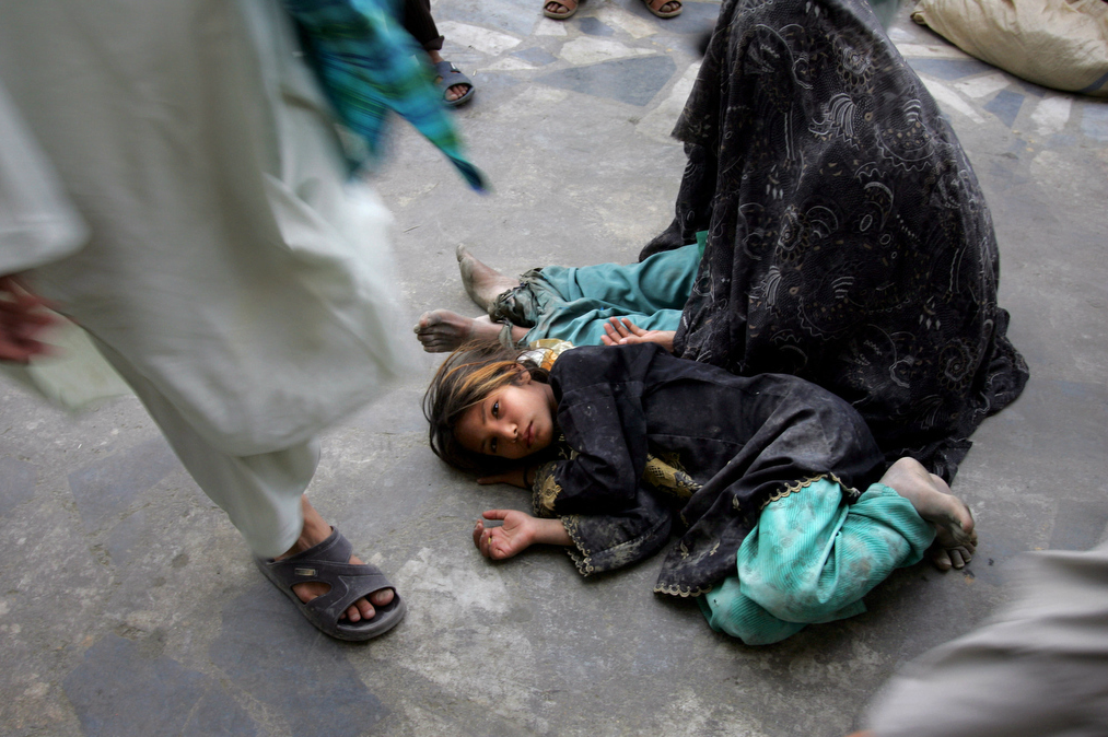 Tumblr - Afghan child on the floor, mother begging