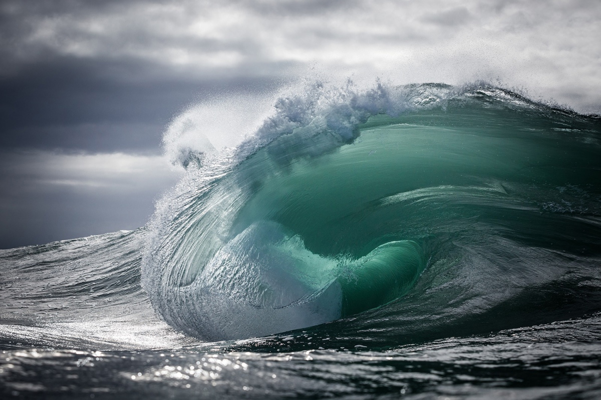 Liquid energy rising from the deep and morphing over a shallow reef before exploding and completing its journey back into the sea. Captured whilst swimming in the ocean using a Canon 5DMKIII + Canon 70-200mm 2.8 lens.   www.WarrenKeelan.com
